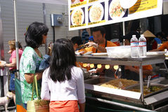 Crowds sample the food Royalty Free Stock Image