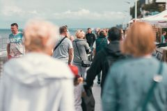 Crowds on a seafront promenade stock photography