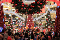 Crowds in shopping mall at Christmas Stock Photos