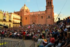 Crowds of spectators at Festival Cultural. Zacatecas, Mexico, 02 August 2013:  The main stage on the Zocalo in front of the cathedral draws a crowd of spectators Royalty Free Stock Photos