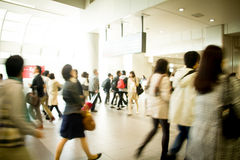 Crowds in station. Walking crowds in a train station in Tokyo, Japan. Fashionable people all rushing towards different directions on a fine day time royalty free stock photography