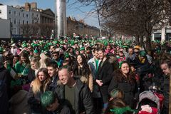 Crowds in the street in Irish top hats and green clothes in Dublin, Ireland on St. Patrick`s Day stock photos