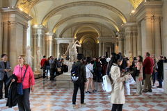 Crowds strolling through rooms of The Louvre, Paris,France,2016 Royalty Free Stock Images