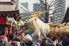 Crowds surround the dragon at the Golden Dragon Dance, Tokyo Stock Photos
