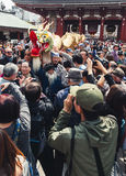 Crowds surround the dragon at the Golden Dragon Dance, Tokyo Royalty Free Stock Photos