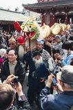 Crowds surround the dragon at the Golden Dragon Dance, Tokyo Stock Image
