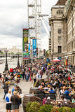 Crowds of Tourists gather outside the London Eye Royalty Free Stock Images