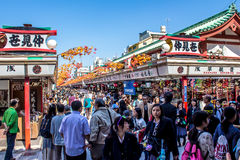 Crowds of tourists at Nakamise-dori. TOKYO, JAPAN - OCTOBER 09, 2015: crowds of tourists at Nakamise-dori, the street with shops at Senso-Ji, The oldest temple Stock Images
