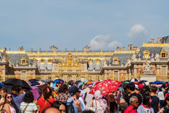 Crowds of tourists at the Palace of Versailles in France Stock Photos