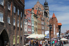 Crowds of tourists walking down the street of the Gdansk old town on the Motlawa river, Poland Royalty Free Stock Photos