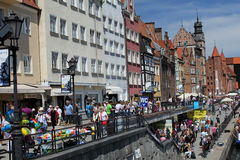 Crowds of tourists walking down the street of the Gdansk old town on the Motlawa river, Poland Royalty Free Stock Images