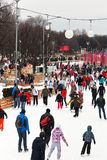 Crowds of townspeople skating rink Stock Image