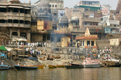 Crowds at Varanasi, India. Crowds on the banks of the River Ganga with boats in the holy city of Varanasi, India Royalty Free Stock Image