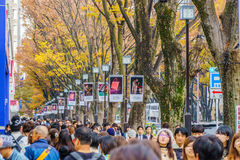 Crowds walk through a Omote Sando Road. Stock Image