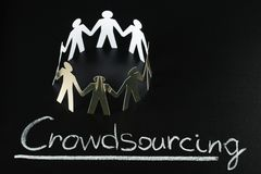 Crowdsourcing concept. Teamwork Concept With Crowdsourcing Word Written On Blackboard Stock Images