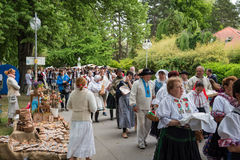 A crowed of artisans dressed in folk costumes Stock Image