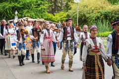 A crowed of artisans marches in the park during the artisan festival Stock Photo
