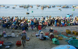 Crowed atmosphere at seafood market on beach Royalty Free Stock Photos