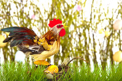 Crowing rooster with easter egg Royalty Free Stock Images