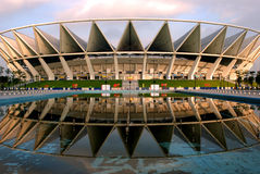 The crown. The Foshan Stadium in Guangdong,China,looks like a crown in the morning sunshine,beautiful reflection in the water Royalty Free Stock Photo