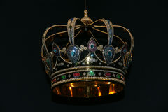 Crown. The beautiful crown in the black Royalty Free Stock Photo