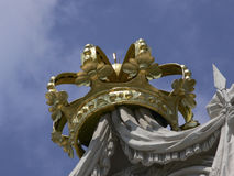 Crown. Golden stone crown at a roof top royalty free stock photo