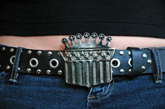 Crown Belt Buckle. Close up of a crown shaped belt buckle and leather belt Royalty Free Stock Photography