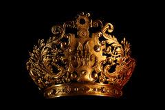 Crown on black. A golden crown isolated on black background
