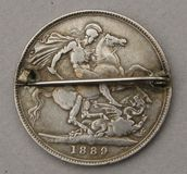 Antique silver crown brooch with horse and dragon Stock Photo
