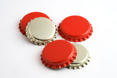 Crown caps. Red and gold crown caps for bottles of beer or wine Stock Photos