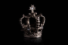 Crown. A closeup of a crown with black background Stock Photos
