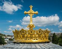 Crown and cross on a dome. Of the Basilica of Our Lady of the Rosary of Lourdes, France Royalty Free Stock Image