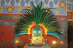 Crown decorated with colorful feathers and flowers. Stands on the stand stock image