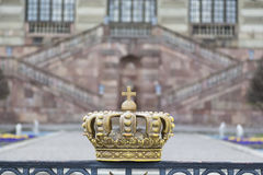 Crown on the fence of the royal palace Royalty Free Stock Images