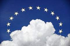 A crown of golden stars. Above a cumulus cloud with a blue sky royalty free stock images