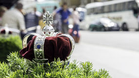 Royal crown. On the green grass stock photos