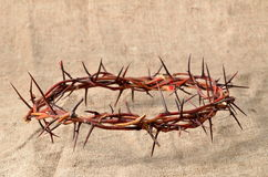 Crown made of thorns on burlap Stock Images