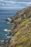 Crown Mines near Botallack Cornwall, UK. Crown Mines, former tin mines, are low down the cliffs north of Botallack. There are two engine houses here and the mine Royalty Free Stock Images