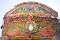 Crown of a Pakistani truck. Decoration pakistani truck front side backside decorated art artist paint painter flower heart culture wheels auto bedford punjab stock image