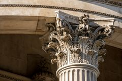 The crown of a pillar with fine sculpture Stock Photography