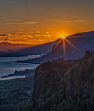 Crown Point Sunrise on the Columbia River. The morning sun peeks over the ridge on the Columbia River with Crown Point in the foreground Royalty Free Stock Images