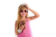 Crown princess blond girl with puppy chihuahua. Dog portrait happy smiling Stock Photography