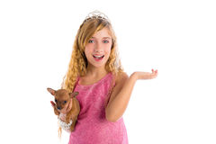 Crown princess blond girl with puppy chihuahua Royalty Free Stock Photos