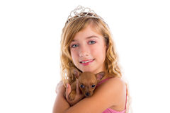 Crown princess blond girl with puppy chihuahua. Dog portrait happy smiling Royalty Free Stock Photo