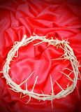 Crown on Red. A crown of thorns on a red woven cloth. Used in the Crucifixion of Jesus in Jerusalem. Easter symbols Royalty Free Stock Image