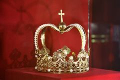 Crown on a red background royalty free stock image