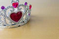 Crown red hearts. On wooden table Stock Image