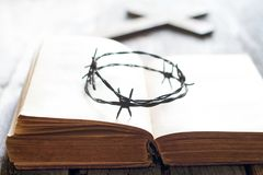 Crown of thorn and bible with cross abstract easter background. Closeup Royalty Free Stock Images