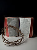 The crown of thorn laid on a bible Stock Image