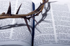 Crown of thorns on Bible. Crown of thorns on open Bible with shadow Stock Image